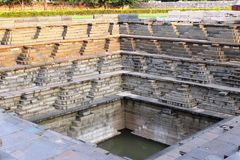Ancient pool. Pool ruins of hampi made with lava basalt and granite Stock Photos