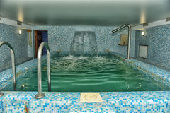 Pool  in the sauna. Pool and waterfall in the sauna Royalty Free Stock Photos