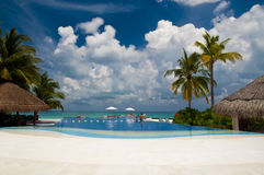 Pool by the sea. Pool at a luxury resort, Maldives Stock Photos