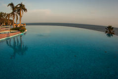 Pool and the sea, Andalusia, Spain Royalty Free Stock Photos