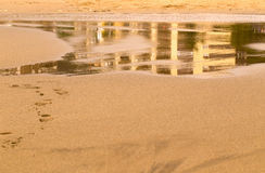 Pool on sea sand with reflection Stock Photography