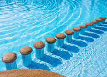 Pool seats in swimming pool Royalty Free Stock Photography