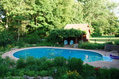 Pool Setting. Where better to spend the hot summer days Stock Image