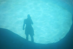 Pool shadow. A man's shadow in a swimming pool Stock Image