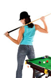 Pool Shark. Sexy young woman in jeans and a hat with a pool cue and her back to the table Royalty Free Stock Photos