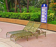 Pool Side Deckchair with Safety First Instruction Board Royalty Free Stock Photo
