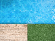 Pool side with green grass and wooden floor Royalty Free Stock Photos