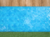 Pool side with green grass and wooden floor Royalty Free Stock Photography