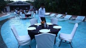 Pool Side Restaurant In Moonlight Stock Image