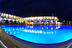 Pool side of a sea resort at night Stock Photo