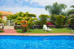 Pool side in tropical garden Royalty Free Stock Images