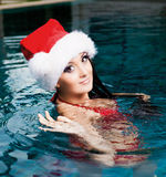 pool simningkvinnan Arkivfoto