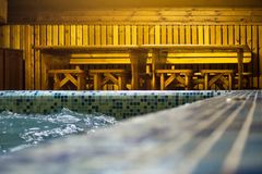 Pool in a small sauna with clear blue water. royalty free stock photography
