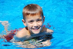 Pool Smile. Boy in the swimming pool Stock Photo