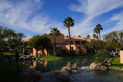Pool and Southwestern style hotel. RANCHO MIRAGE, CALIFORNIA - DEC 20, 2014 - Pool and Southwestern style hotel buildings in green oasis with Palm trees, Rancho stock image
