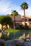 Pool and Southwestern style hotel. RANCHO MIRAGE, CALIFORNIA - DEC 20, 2014 - Pool and Southwestern style hotel buildings in green oasis with Palm trees, Rancho stock photo