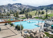 Pool and Squaw Peak. Squaw Peak and pool at High Camp, above Squaw Valley, California Royalty Free Stock Photos
