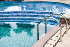 Pool with stair. A Swimming pool with steel stair Stock Photo