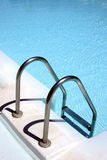 Pool Steps. Steps into a bright blue pool Royalty Free Stock Photos