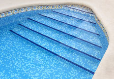 Pool Steps. Steps leading into a swimming pool royalty free stock images