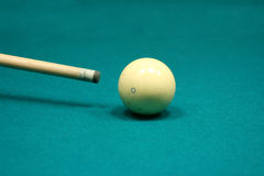 Pool stick and cue ball Stock Images