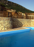 Pool and stone wall Stock Photography