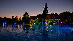 Pool Summer Party, Holidays Colorful Night Scene, Friends having Fun, Travel Portugal stock image