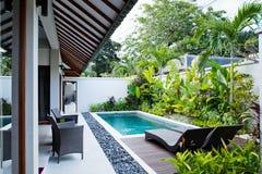 Pool with sunbed. In Bali villa backyard Stock Photography
