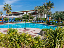 Pool and sunbeds in hotel resort Dubai Stock Photos