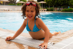 In the pool. Sunny day -the best time to visit the pool royalty free stock photography