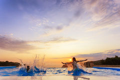 Pool with sunset Stock Image