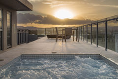 Pool at sunset luxury home Stock Image