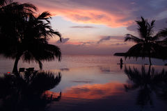 Pool sunset. Sunset over the infinity pool at Vilamendhoo, Ari Atoll, Maldives Royalty Free Stock Image