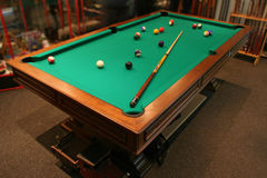 Pool table. With balls and cue stock photography
