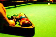 Pool table. A female pool player bending over the green table and ready to hit the white ball Royalty Free Stock Photos