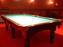 Pool Table. A pool table in a luxurious room Royalty Free Stock Photo