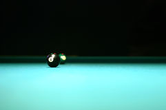 Pool Table 8 Ball. 8 Ball resting on isolated Pool Table stock photos