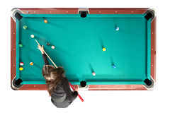 Pool table from above. Pool table with a girl playing, seen from above, isolated on white royalty free stock photos