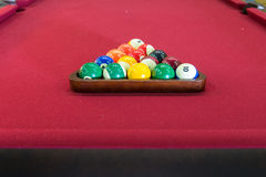 Pool Table / Balls Racked Up on Red. Red Pool Table / Balls Racked Up in triangle and ready for game of pool Stock Photos
