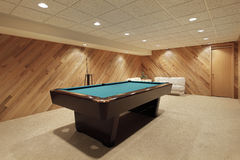 Pool table in basement Stock Photos
