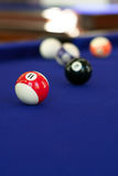 Pool Table Billiard Balls. Billiard balls on a purple fabric pool table. Shallow depth of field with sharpest focus on the 11 ball Royalty Free Stock Images