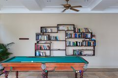 Pool table and bookshelf on white background. Stock Image