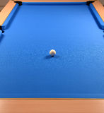 Pool table and cue ball Royalty Free Stock Image