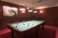 Pool table in elegant red room Stock Image