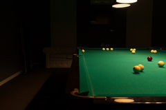 Pool Table in Empty Dimly Lit Pool Hall Stock Image