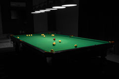 Pool Table in Empty Dimly Lit Pool Hall Royalty Free Stock Image