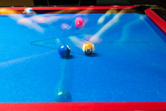 Pool table with motion blur on balls Stock Photos