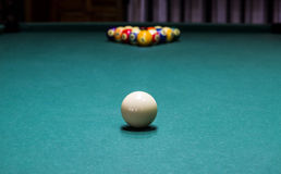 Pool table. Shallow DOF on the white ball Royalty Free Stock Photos