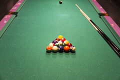 Pool table for teenagers Stock Images