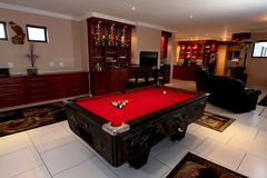 Pool table. In upmarket South African home, red velvet cover, made from wood. Can also be used for snooker or billiards Royalty Free Stock Photos